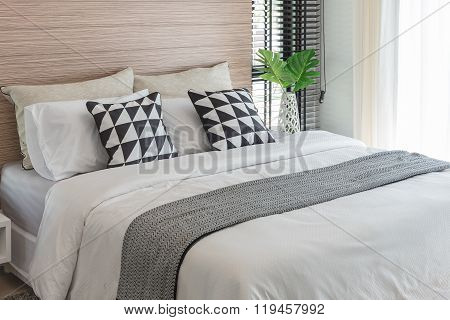 Black And White Pillows On Bed In Modern Bedroom