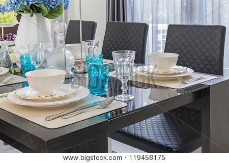 Modern Dinning Room With Table Set On Glass Table