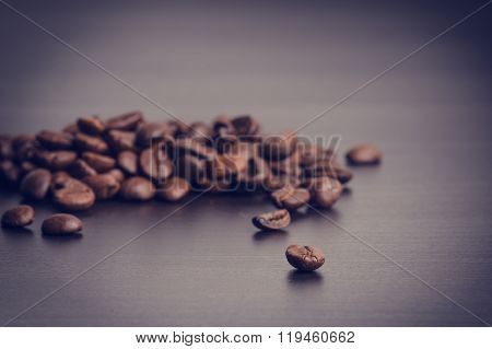 Coffee beans on a black background. Levitation of coffee beans. Raw coffee beans. Grained product. H