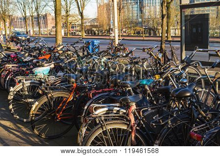 AMSTERDAM, NETHERLANDS - 16TH FEBRUARY 2016: Large amounts of Bicyles at docking stands in Amsterdam during the day.