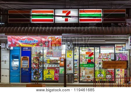 BANGKOK, THAILAND, JANUARY 15, 2016 : Illuminated Seven Eleven convenient store with ATM machines along the Sukhumvit street at Thong Lor district in Bangkok, Thailand.