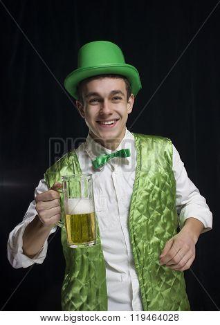 A man (Saint Patrick) smile in a green