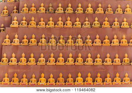 Tiny Buddha statues row in Wat Tam Phu Wa temple in Kanchanaburi, Thailand