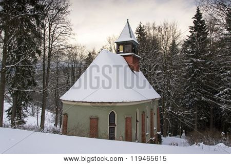 Church Of The Saint Joseph In Wood In Frosty Mountains Country Winter Evening