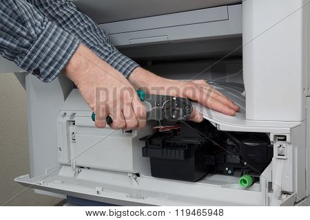 Side View Of Businessman Adjusting Cartridge In Photocopy Machine