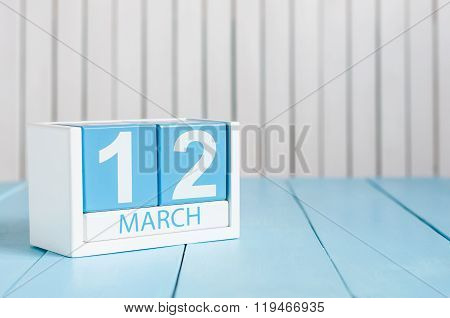 March 12th. Image of march 12 wooden color calendar on white background. Spring day, empty space for