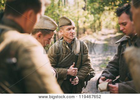 Group unidentified re-enactors dressed as Soviet soldiers