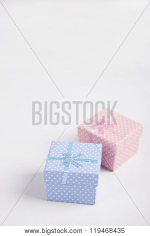 Blue And Pink Spotted Squared Gift Boxes On White Background