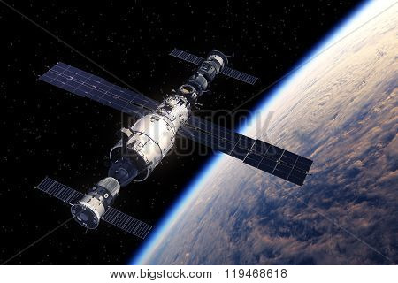 Space Station And Spaceships Orbiting Earth