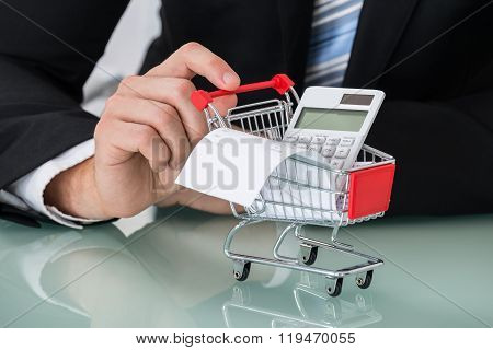 Close-up Of Man Holding Shopping Trolley