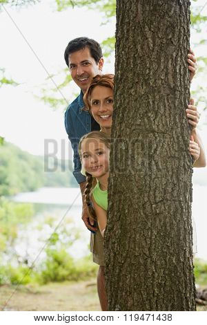 Family looking around a tree