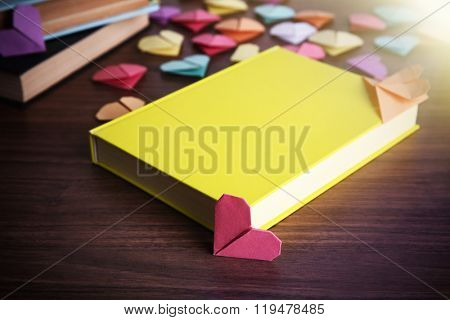Heart bookmarks for books on wooden background
