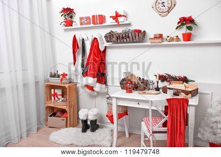 Santa costume hanging in white room