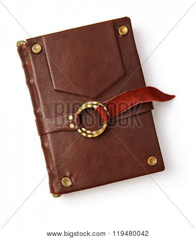 Vintage book in leather cover with gold ring and thong. Isolated white background