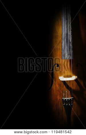 Vintage cello on dark background