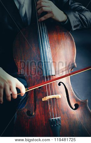 Man playing on cello close-up