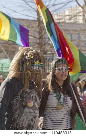 Mardi Gras Costumes And Rainbow Flags