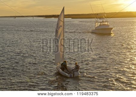 Sunset Boating On Rippled Waters