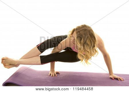a woman showing off her strength by doing a yoga hold.