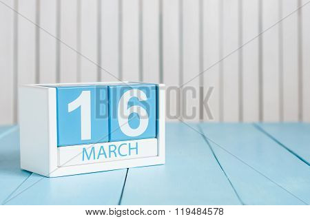 March 16th. Image of march 16 wooden color calendar on white background.  Spring day, empty space fo