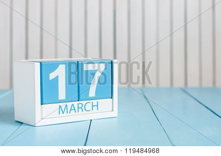 Happy St Patricks Day save the date. March 17th. Image of march 17 wooden color calendar on white ba