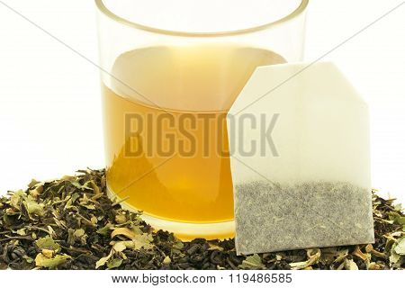 Glass Cup Of Tea With Some Dried Tea Leaves.