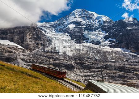 Train Running Under The Monch And Eiger Glacier