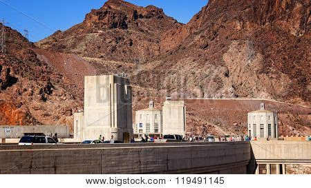 Automobiles And Tourists Move Along The Hoover Dam