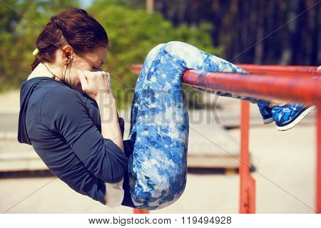 woman doing abs exercises outside. outdoor workout on a sunny day