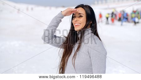 Gorgeous smiling young woman at a ski resort