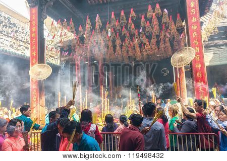 Pilgrims queue at temple incense New Year's Day