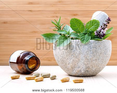 Alternative Health Care Fresh Herbs Basil ,sage ,rosemary, Mint  And Herbal Capsule With Mortar On W