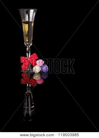 Glass Of Champagne With Reflection On Black Background