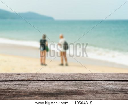 Wood Table Top On Blurred Blue Sea And White Sand Beach