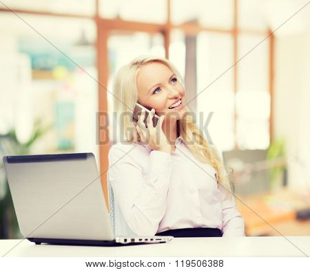 education, business, communication and technology concept - smiling businesswoman or student with laptop computer calling on smartphone over office room background