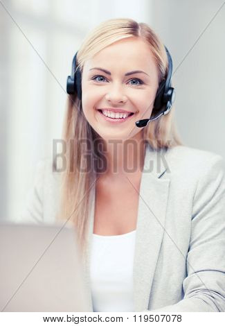 business, call centre and technology concept - female helpline operator with headphones and laptop pc