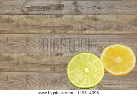 fresh slices of lemon and lime on wooden table background