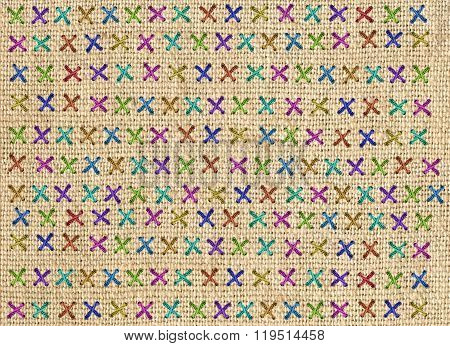 Close up of colorful cross stitch detail on designer cushion