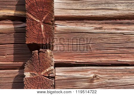 Closeup, macro of red painted logs, timber on a buildings wall.