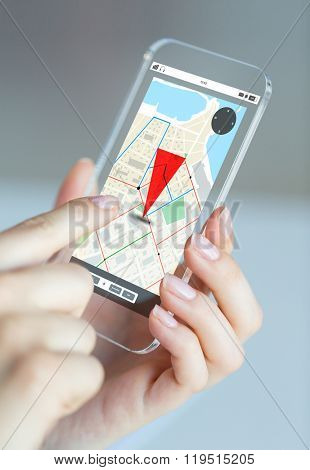 business, technology, navigation and people concept - close up of woman hand holding and showing transparent smartphone with gpas navigator map on screen