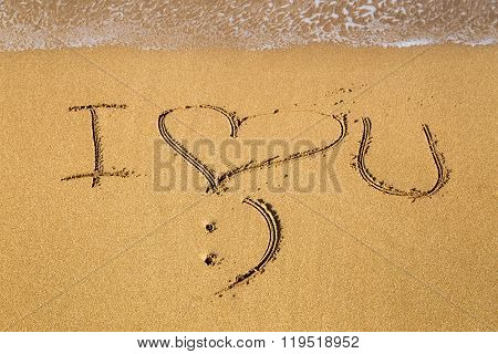 Message I Love You Written in Sand