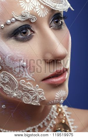 Gorgeous Woman With Extravagant Bridal Make Up
