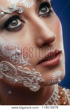 Woman Looking Up With Bridal Extravagant Make Up