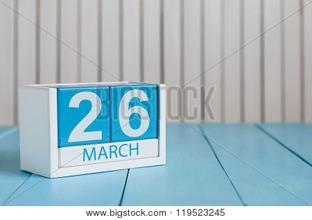 March 26th. Image of march 26 wooden color calendar on white background.  Spring day, empty space fo