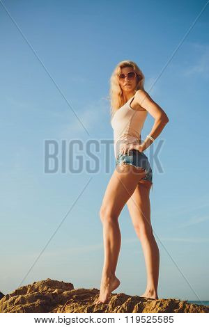 Beautiful  Blond Woman In Shorts And T-shirt At The Sea.