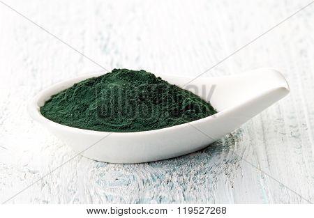 Spirulina Powder In White Porcelain Spoon