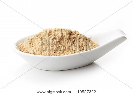 Maca Powder In White Porcelain Spoon