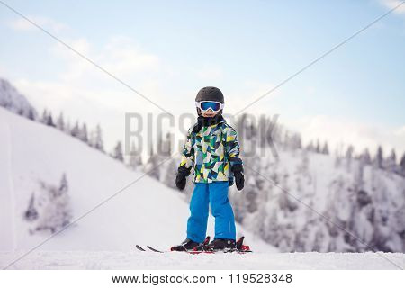 Cute Preschool Child, Boy, Skiing Happily In Austrian Ski Resort, Wintertime