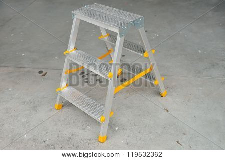 Picture Of A Small Foldable Ladder On Sidewalk