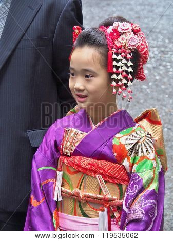 Girl dressed in traditional dress called Kimono